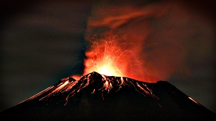 Smoke rises from the Popocatepetl as it spews incandescent volca
